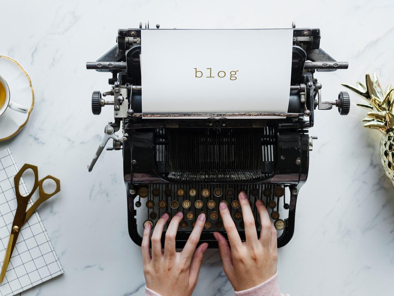 Hands typing on an antique typewriter